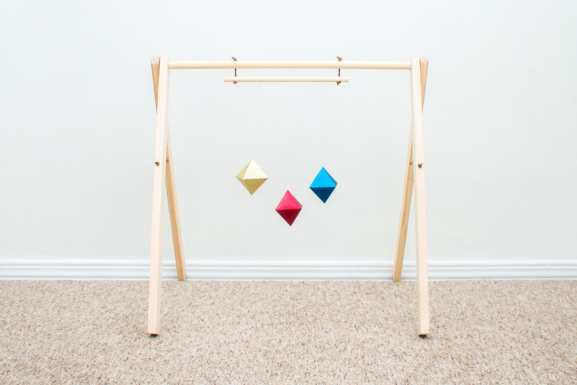 montessori-octahedron-mobile-attached-to-play-gym