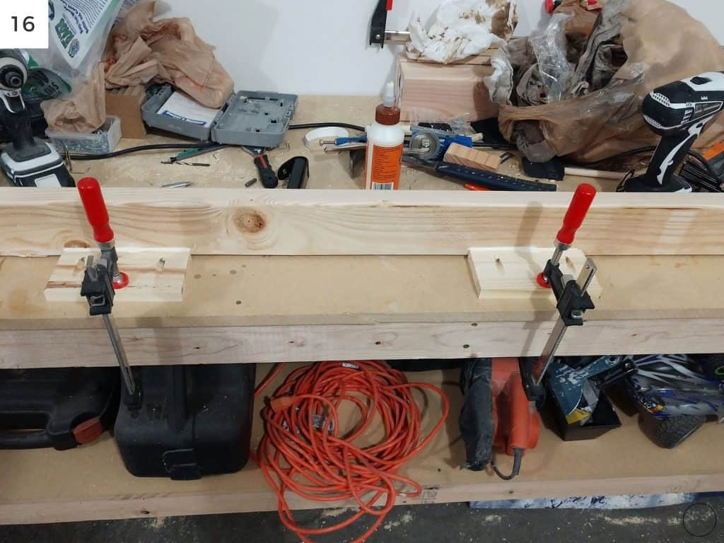 a space board that will be installed between the IKEA Billy bookcases and the modern farmhouse electric fireplace is created using Kreg Jig scews and clamps