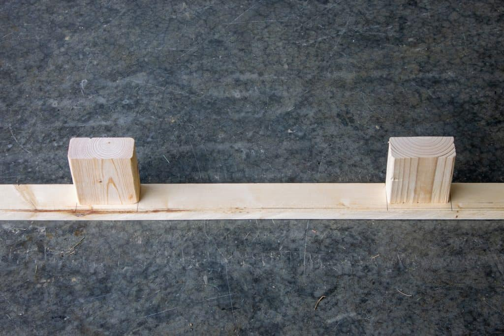 How to build a modern farmhouse floating mantle. Assembly picture showing the 2x4 braces attached to the back plate of the mantle.