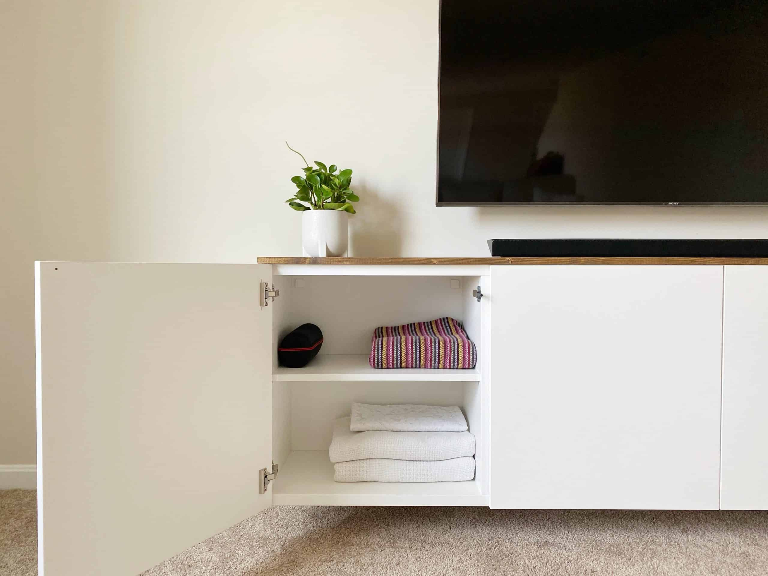 A floating TV console is just one way to maximize storage and organization in a home with children. Learn how to use IKEA's BESTA cabinets to create a super simple floating TV console at www.freeandunfettered.com. It's a sleek and practical piece of furniture for any family room.