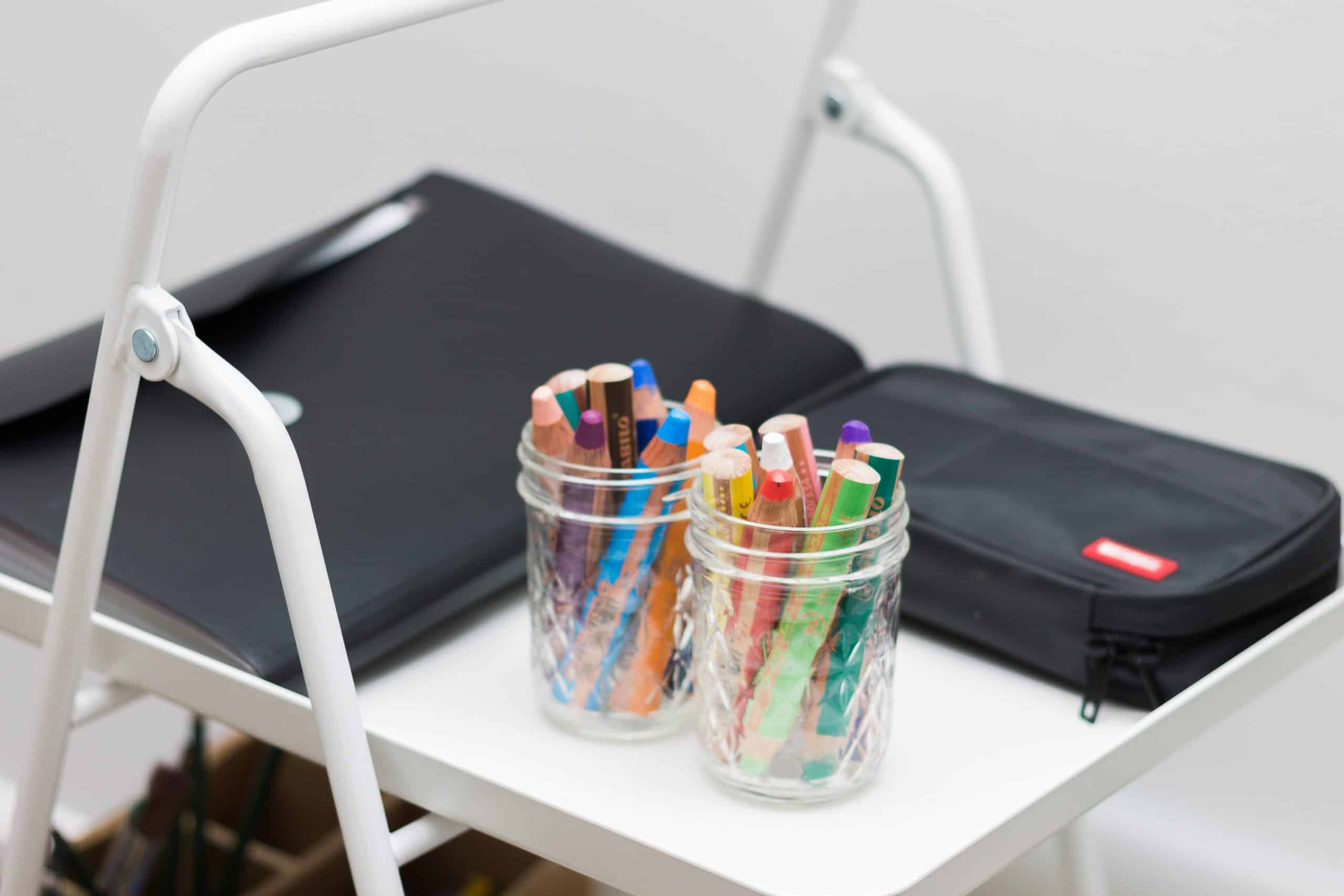 Art supplies and materials are being stored on IKEA's VIGGJA Tray Cart to make an accessible art station for young children in a Montessori-inspired home.