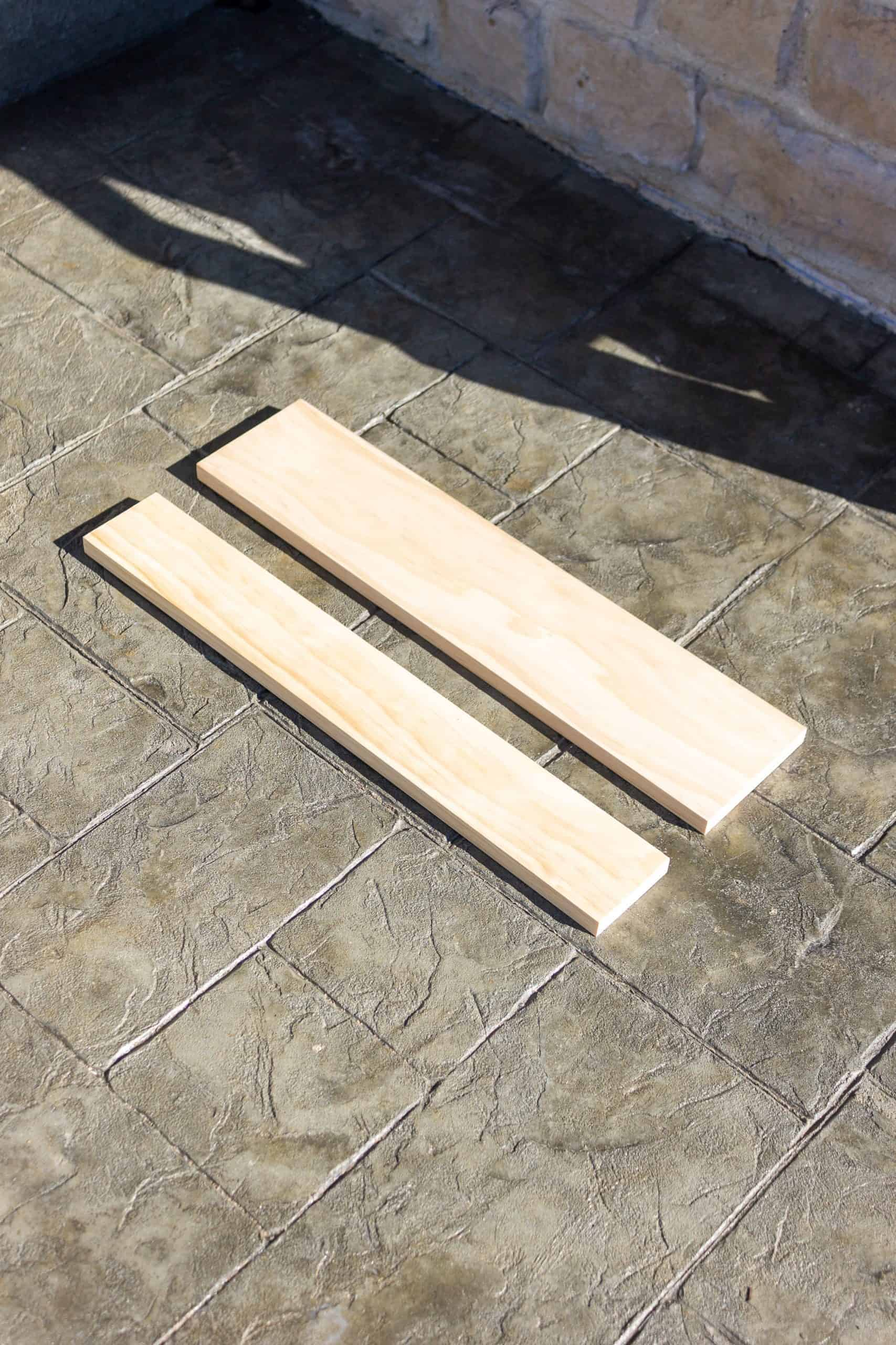 """Use just a 1"""" x 6"""" select pine board and a dowel to build a DIY Wooden Peg Rail Shelf with Mail Holder for as little as $30 dollars."""