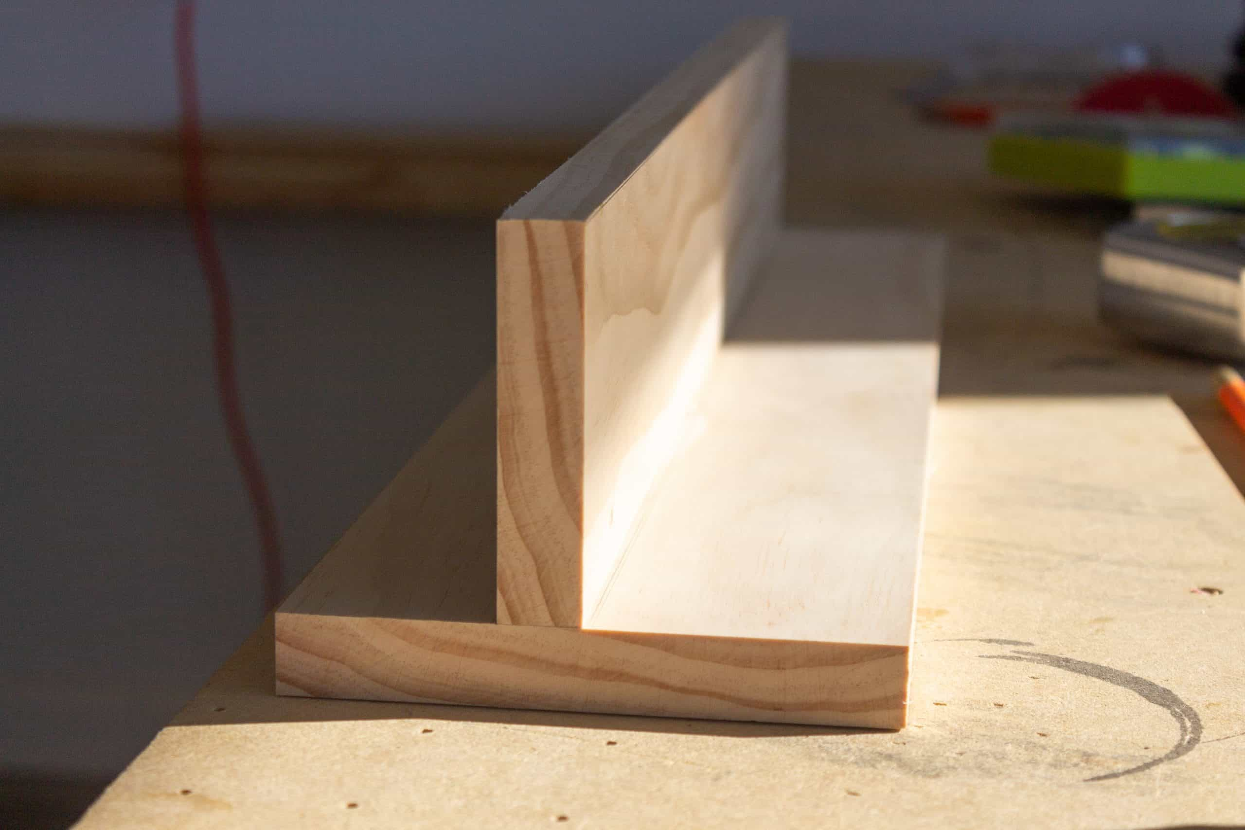 Place the peg rail shelf perpendicular to the back board and trace it. Then continue assembling the wooden peg rail shelf with mail holder.