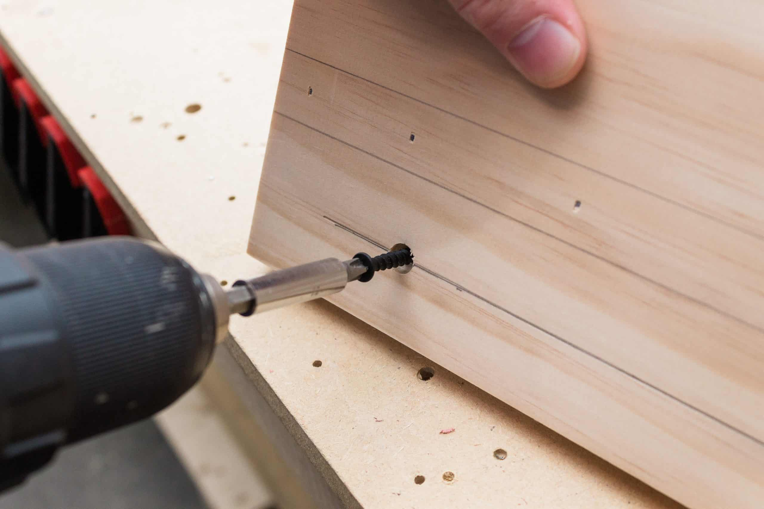 Use a countersink bit to drill the holes for the dowels when assembling the peg rail shelf.