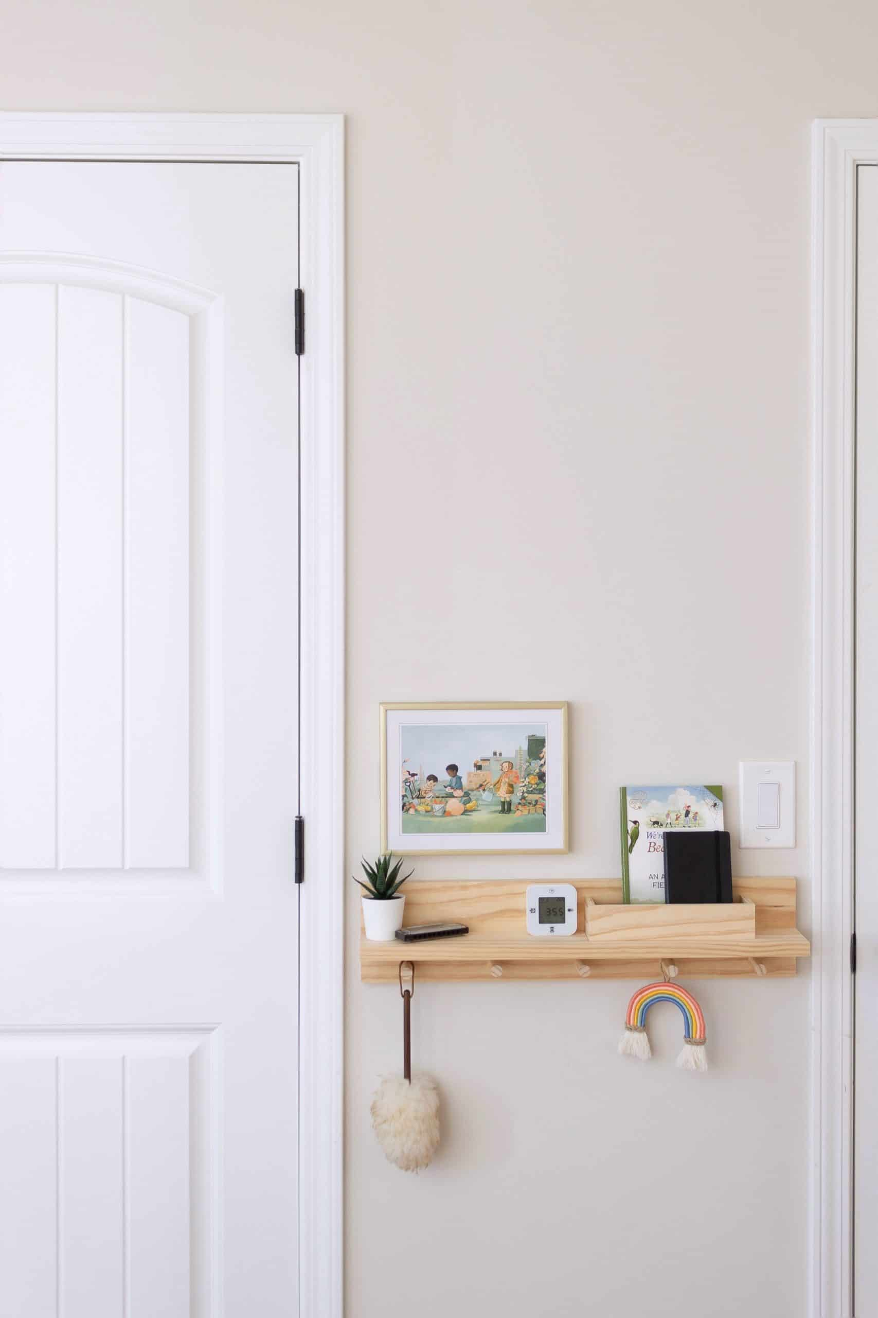 Learn how to build a wooden peg rail shelf with letter bin to help control the clutter in an entryway or bedroom area. It's a perfect small-space organization item that can be built for as little as $30 dollars! See the complete tutorial at www.freeandunfettered.com.