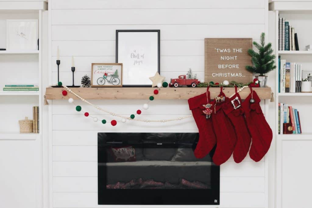 A DIY shiplap fireplace build featuring a Touchstone Sideline electric fireplace insert and Billy bookcases from IKEA.